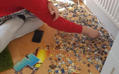 A boy in room 30 makes a 1,000 piece jigsaw