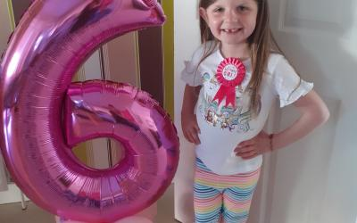 A girl from room 5 celebrates her 6th birthday