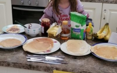 A girl from room 11 sets up a Pancake Stall