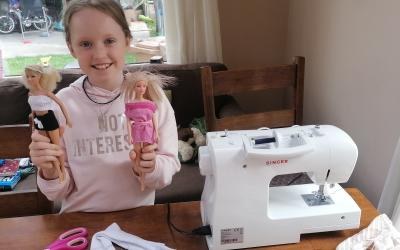 A girl from room 11 has been busy making clothes from old socks for her Barbie doll