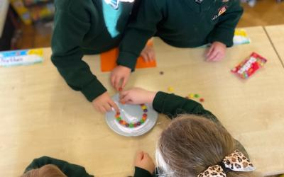 The children in Junior Infants were busy arranging skittles before their teacher poured on some warm water...